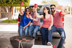 Friends drinking and having fun outdoors Royalty Free Stock Image
