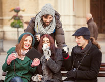 Friends Drinking Hot Beverage Outdoors. Group Of Young Friends Drinking Hot Beverage Outdoors royalty free stock photo