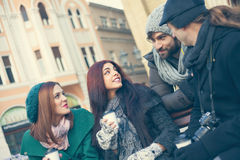 Friends Drinking Hot Beverage Outdoors. Group Of Young Friends Outdoors Drinking Hot Beverage And Using Technology stock images