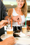 Friends drinking milk coffee and eating cake. In a bar or Cafe Royalty Free Stock Photo