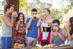 Friends drinking in the park stock photo