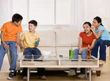 Friends drinking soda and telling secrets Stock Image