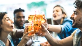 Free Friends Drinking Spritz At Fashion Cocktail Bar Restaurant - Friendship Concept With Young People Having Fun Together Stock Image - 147931801