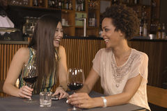 Friends drinking wine at a restaurant. Stock Photography