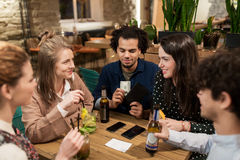 Friends with drinks, money and bill at bar Royalty Free Stock Images