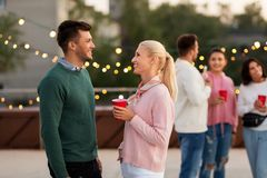 Friends with drinks in party cups at rooftop stock photography