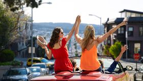 Friends driving in car at san francisco Stock Photo