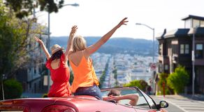 Friends driving in car at san francisco stock images