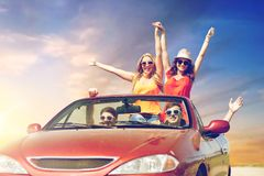 Friends driving in convertible car at country Royalty Free Stock Images