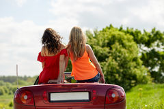 Friends driving in convertible car at summer Royalty Free Stock Image