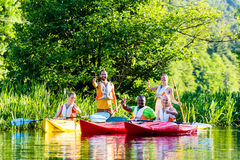 Friends driving with kayak on river. Friends driving with kayak on forest river Royalty Free Stock Image
