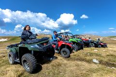 Friends driving off-road with quad bike or ATV and UTV vehicles Stock Photos