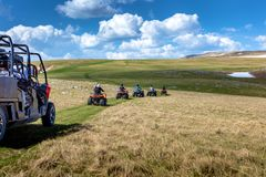Friends driving off-road with quad bike or ATV and UTV vehicles royalty free stock images