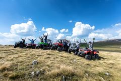 Friends driving off-road with quad bike or ATV and UTV vehicles stock images