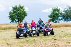 Friends driving off-road with quad bike or ATV. Young Friends driving off-road with quad bike or ATV Royalty Free Stock Photos