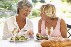 Friends Eating An Al Fresco Meal Royalty Free Stock Image