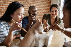 Free Friends Eating Chow Mein Together Royalty Free Stock Photography - 109708927