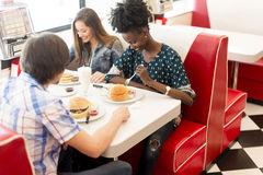 Friends eating in diner Royalty Free Stock Image