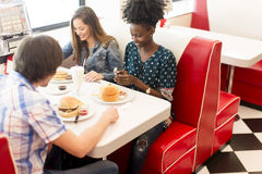 Friends eating in diner Stock Photos