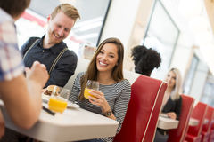 Friends eating in diner Stock Photo