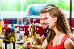 Friends eating and drinking in fast food diner Stock Image