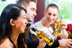 Friends eating and drinking in fast food diner Stock Images
