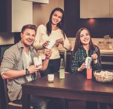 Friends eating fast food at home Royalty Free Stock Image
