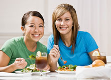 Friends eating healthy lunch and smiling Stock Photo