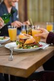 Friends Eating Lunch at Cafe Royalty Free Stock Photography