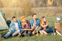 Friends eating pizza at the camping Royalty Free Stock Images