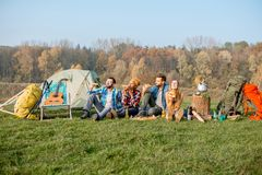 Friends eating pizza at the camping Stock Photography