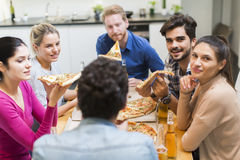 Friends eating pizza Royalty Free Stock Image