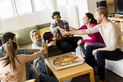 Friends eating pizza Royalty Free Stock Photos