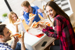 Friends eating pizza Stock Photography
