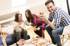 Friends eating pizza Stock Photo