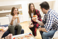 Friends eating pizza Stock Images