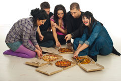 Friends  eating pizza  home Stock Photo