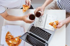 Friends eating pizza at home party, closeup.  Royalty Free Stock Photo