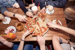 Friends eating pizza at home party, closeup stock image