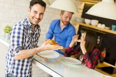 Friends eating pizza Royalty Free Stock Photography