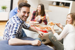 Friends eating pizza in th room Royalty Free Stock Image