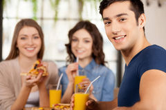 Friends eating pizza. Stock Photography