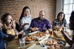 Friends eating pizza together at home Royalty Free Stock Images