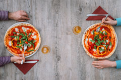 Friends eating pizza together Stock Images