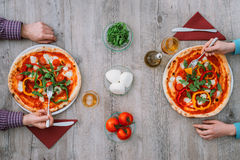 Friends eating pizza together Royalty Free Stock Photos