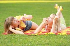 Friends eats cherries in park Stock Photo