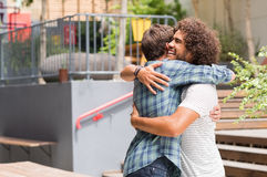 Friends embracing each other Royalty Free Stock Photos