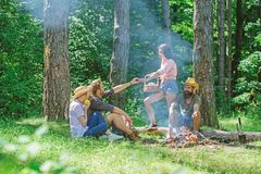 Friends enjoy picnic eat food nature forest background. Plan for perfect day hike picnic. Company friends or family royalty free stock photos