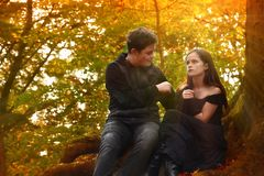 Friends enjoy a romantic mood in the autumn forest