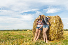 Friends enjoy sunny day together in countryside Stock Photo